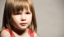 Little girl's face Stock Images