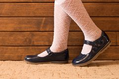 Little girl`s feet in leather shoes . Close up royalty free stock images