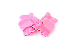 Little girl's gloves. Pink gloves to fit a little girl isolated on a white background Royalty Free Stock Photography
