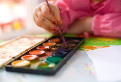 Little girl's hand with painting brush Stock Photo