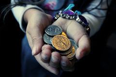 Little girl's hands with coins. Little girl's hands with small coins Royalty Free Stock Photos