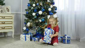 Little girl with a new year gift stock video footage