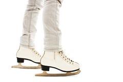 Little Girl's Legs in White Ice Skates Stock Photography