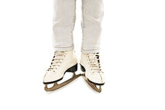 Little Girl's Legs in White Ice Skates Royalty Free Stock Images