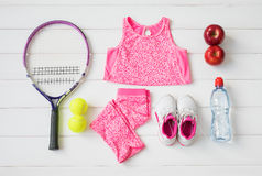 Little girl`s sports equipment stock photography