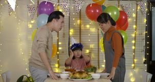 Little girl is sad because of her parents quarrelling in her birthday party. stock video