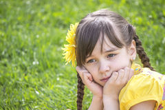 Little girl sad looks and thinks. In park Stock Photography