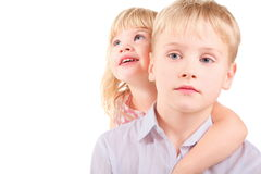 Little girl and sadness little boy. Sister is embracing her brother. isolated Stock Photos