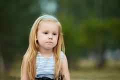 Sadness. Thoughtfulness. Little girl. Portrait child. Blonde Royalty Free Stock Photography