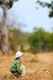 Little girl on safari. Adorable little girl in South Africa safari with giraffe toy Stock Image