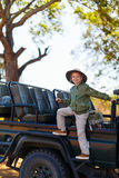 Little girl on safari. Adorable little girl in South Africa safari on morning game drive near open vehicle Royalty Free Stock Photography