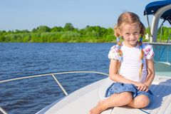 Little girl sailing on a luxury yacht Stock Photos