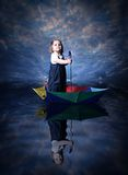 Little girl sailing using the umbrella Royalty Free Stock Photography