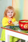 Little girl with salat Royalty Free Stock Photos