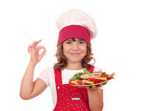 Little girl with salmon seafood and ok hand sign Stock Photo