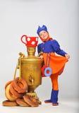 Little girl with samovar Royalty Free Stock Photos
