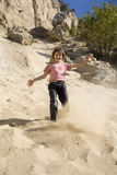 Little girl in the san-pit Stock Images