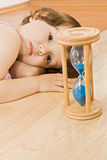 Little girl with sand glass Royalty Free Stock Photos