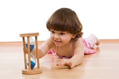 Little girl with sand glass Stock Images