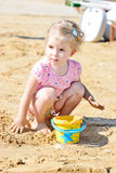 Little girl in sand Royalty Free Stock Images