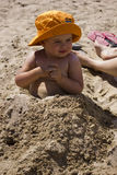 Little girl in the sand Stock Images