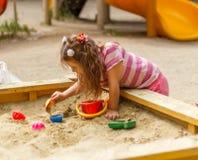 Little girl in sandbox Royalty Free Stock Image