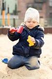 Little girl in sandbox. Stock Photo