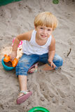 Little girl in sandbox Stock Image
