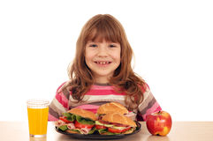 Little girl with sandwiches apple and juice Royalty Free Stock Image