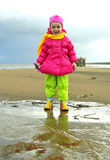 Little girl  on a  sandy autumn coast Royalty Free Stock Images