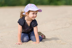 The little girl on a sandy beach. Stock Image