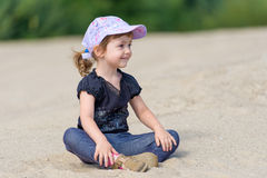 The little girl on a sandy beach. Royalty Free Stock Photos