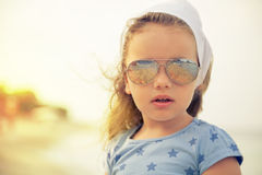 Little girl on sandy beach Stock Image