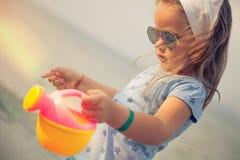 Little girl on sandy beach Royalty Free Stock Image