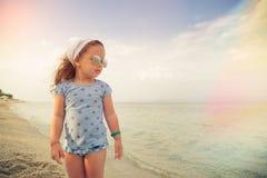 Little girl on sandy beach Stock Photography