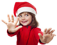 Little girl with a santa cap Royalty Free Stock Image