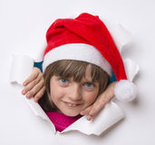 Little girl with santa cap Stock Photo