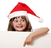 Little girl with santa cap Royalty Free Stock Images