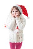 Little girl in santa cap wait for christmas Stock Image