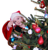 Little girl Santa Claus Stock Images