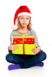 Little girl with Santa- Claus cap looking amazed Royalty Free Stock Photography