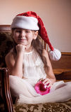 Little girl in Santa Claus clothes Stock Images