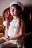 Little girl in Santa Claus clothes Stock Photos