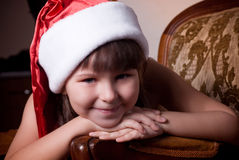 Little girl in Santa Claus clothes Royalty Free Stock Images