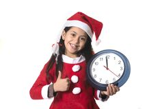 Little girl on Santa Claus costume holding Watch Royalty Free Stock Images