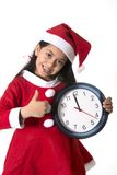Little girl on Santa Claus costume holding Watch Stock Photography