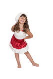 Little girl in Santa Claus costume is leaning forward royalty free stock photo