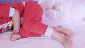 Little girl in santa claus costume sleeps sweetly on bed stock video footage