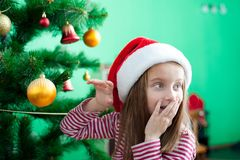 Little girl in the santa claus hat Royalty Free Stock Images