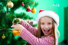 Little girl in the santa claus hat Stock Photos